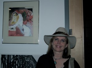 Karen with her painting, 'All That You Dream' at the ArtRocksAthens opening