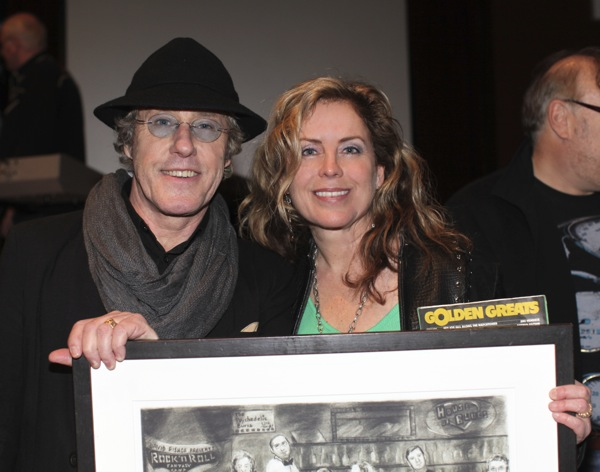 Karen Adams presents artwork to Roger Daltrey.